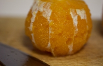 cut rind off orange